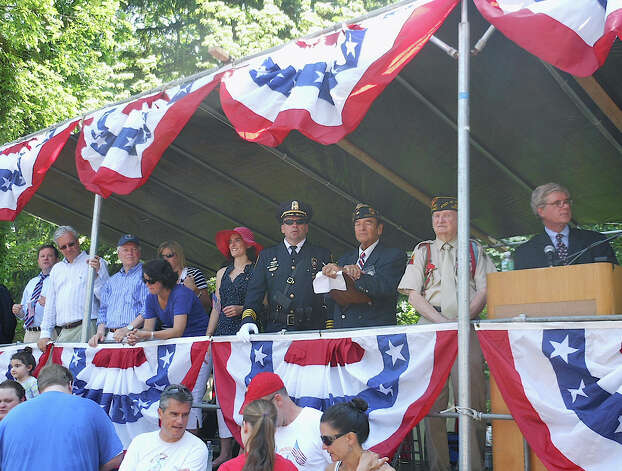 Fairfield officials and veterans on the Memorial Day parade reviewing stand Monday on Town Hall Green. Photo: Mike Lauterborn / Fairfield Citizen contributed