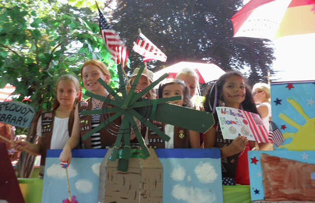 Girl Scouts from Troops 33014 and 33410 in their prize-winning float Monday in the Memorial Day parade. Photo: Mike Lauterborn / Fairfield Citizen contributed