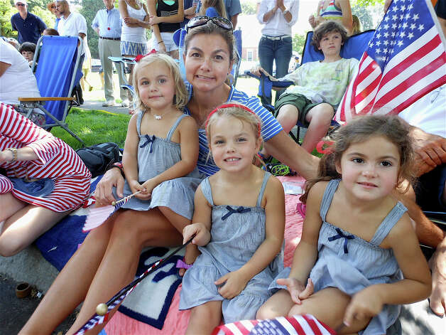Jessica Wheeler of Fairfield and daughters Gigi, Hayes and Ellie watching the Fairfield Memorial Day parade on Monday. Photo: Mike Lauterborn / Fairfield Citizen contributed