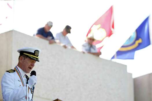Captain Richard L. Halferty USNR (ret.) gives a speech during the Memorial Day ceremony at the Houston National Cemetery, Monday, May 28, 2012, in Houston. Photo: Karen Warren, Houston Chronicle / © 2012  Houston Chronicle
