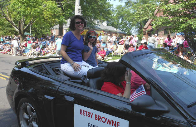 Fairfield Town Clerk Betsy Browne in her Memorial Day parade convertible Monday on the Old Post Road. Photo: Mike Lauterborn / Fairfield Citizen contributed