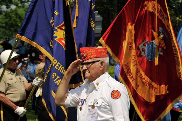 Jose Gomes, Sergeant at Arms of the Marine Corps League, salutes the American flag during the playing of the Star Spangled Banner at the Rose Arbor ceremony at Rogers Park after the Danbury Memorial Day Parade on Monday, May 28, 2012. Photo: Jason Rearick / The News-Times