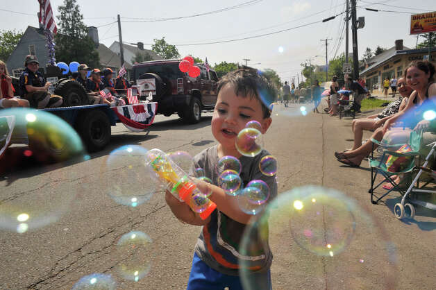 Dylan Albuquerque, 2, of Danbury, blows bubbles during the Danbury Memorial Day Parade on Monday, May 28, 2012. Photo: Jason Rearick