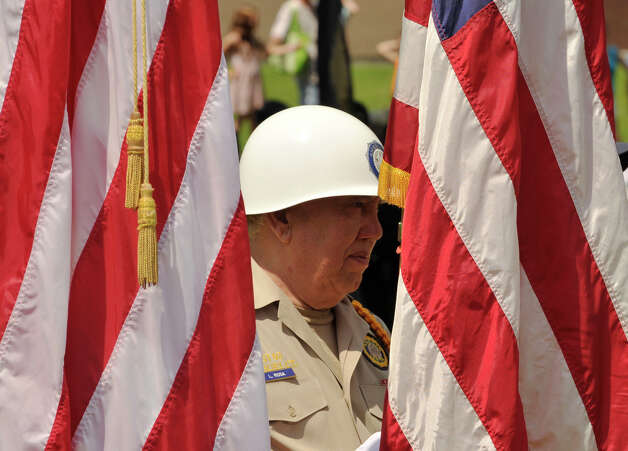 American Legion member Louis Rosa holds the American flag during the Rose Arbor ceremony after the Danbury Memorial Day Parade on Monday, May 28, 2012. Photo: Jason Rearick / The News-Times