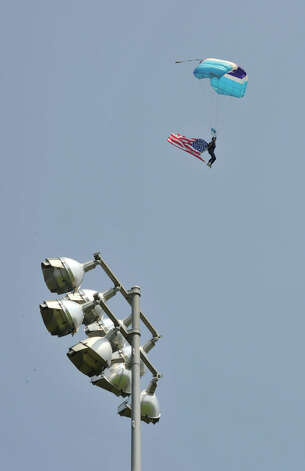 Kay Hoiby, of Gardiner, N.Y., with Skydive the Ranch, parachuttes into Rogers Park during the Danbury Memorial Day Parade on Monday, May 28, 2012. Photo: Jason Rearick / The News-Times