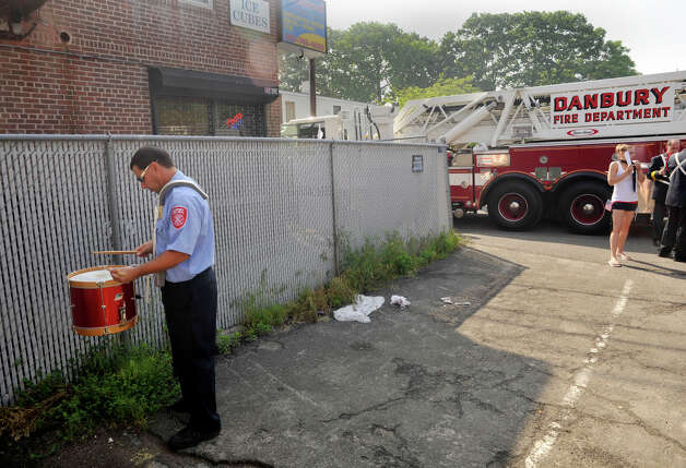 Danbury firefighter Dave Cianciolo practices his drumming before the Danbury Memorial Day Parade on Monday, May 28, 2012. Photo: Jason Rearick / The News-Times