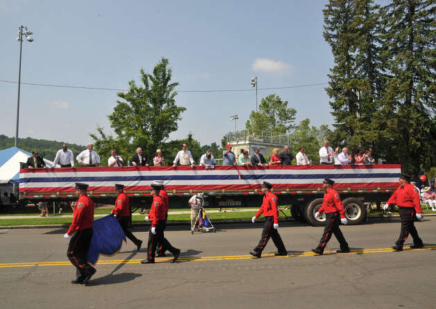 Members of the Padanaram Hose Company 3 march past the reviewing stand during the Danbury Memorial Day Parade at Rogers Park on Monday, May 28, 2012. Photo: Jason Rearick / The News-Times