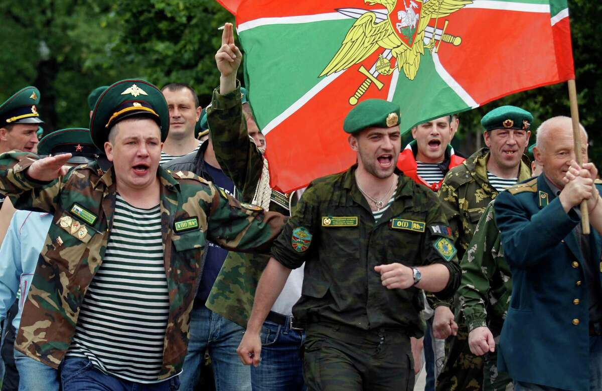 Former Russian border guards march with their flag in Moscow's Gorky Park, Russia, Monday, May 28, 2012, as they celebrate border guards day.