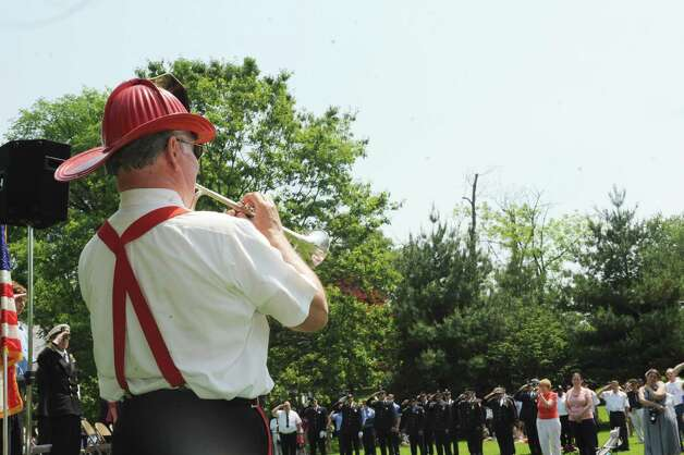The Sound Beach Volunteer Fire Department band member Vincent Lukason played tapes at the cerermony after the Sound Beach Fire Department's Memorial Day Parade in Old Greenwich Monday, May 28, 2012. Photo: Helen Neafsey / Greenwich Time
