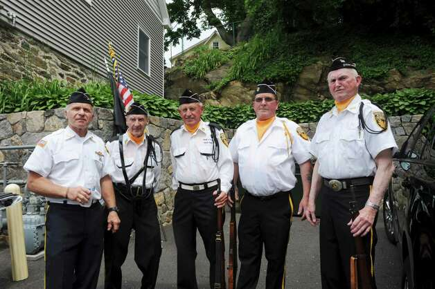 From left, veterans Joe Kralik Jr., Dennis Hughes, John Zmarzlak, Jim McMurray and Walter Casey get ready for the Byram Veterans Association's Memorial Day Parade Sunday, May 27, 2012. Photo: Helen Neafsey / Greenwich Time