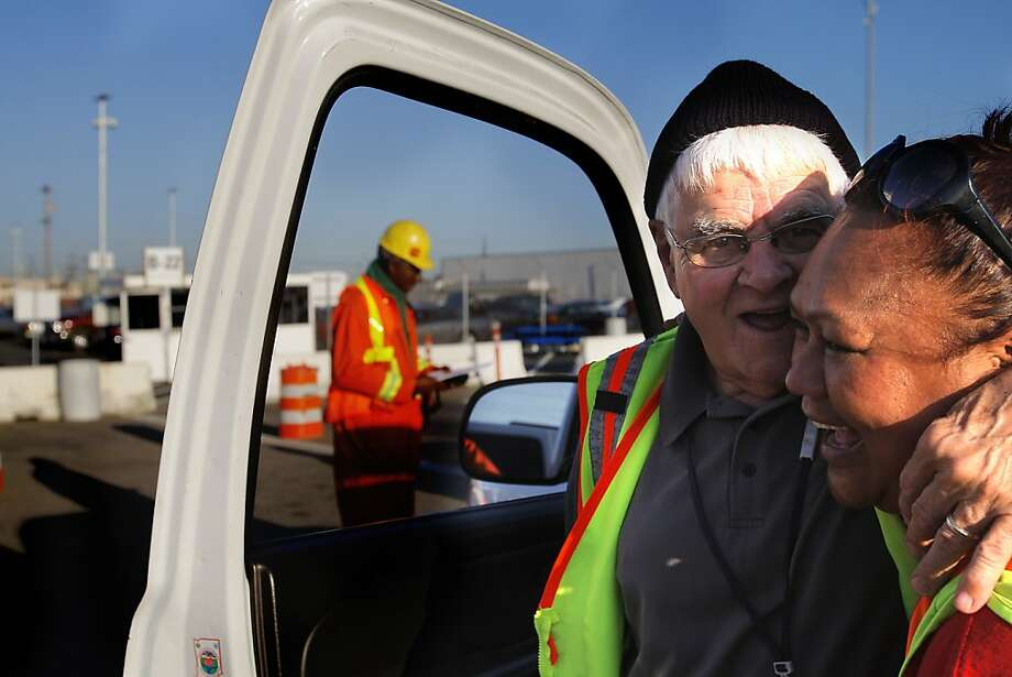 "Johnie Thomas, center, gets off his track to greet Rose Faaola after he checks her in for the 7 p.m. shift at the Port of Oakland, Calif. on May 11, 2012, where he's been working for 56 years. He just turned 79 and still works full-time at night. He has done all the jobs on the waterfront and for the last 20 years he's been a supervisor. ""I am a loved supervisor"" - smiles Thomas as people greed him and no one believes his plans to retire on August 1st this year. Photo: Siana Hristova, The Chronicle"
