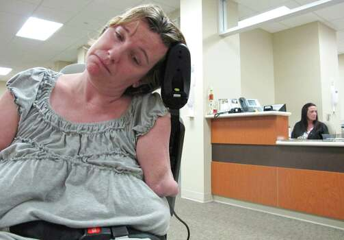 Katy Hayes stresses about how to pay for her radiology appointment at Kingwood Medical Center Tuesday May 22, 2012. Katy Hayes is in the process of medically preparing her body for arm transplants. Photo: Billy Smith II, Chronicle / © 2012 Houston Chronicle