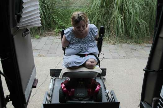 Katy Hayes  arrives home from a long day at the at Kingwood Medical Center Tuesday 22, 2012. Hayes is preparing  her body for her arm transplants. Photo: Billy Smith II, Chronicle / © 2012 Houston Chronicle