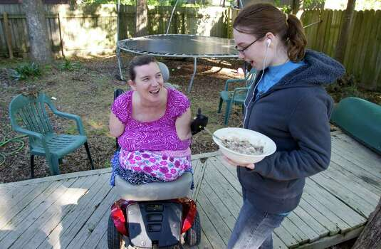 Katy Hayes laughs with her eighteen year-old daughter Amber Bothne   while eating lunch in the backyard of her home in KIngwood, April 14, 2012 Photo: Billy Smith II, Chronicle / © 2012 Houston Chronicle