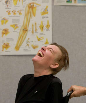 Katy Hayes looks up to smile and laugh talking about her  new conventional prosthetic arms Thursday, June 24, 2010, at Muilenburg Prosthetics in Houston, Texas.  After hearing of Katy's story  Ted Muilenburg donated the prosthetic arms to Katy Hayes.   Shortly after the birth of Katy's daughter, Arielle, Katy Hayes began to experience intense pain and went to the local hospital. She is currently battling for her life after a series of complications resulting from a Streptococcal A infection. As a result, Katy has experienced multiple organ failure and the loss of her arms and legs. Photo: Billy Smith II, Houston Chronicle / Houston Chronicle