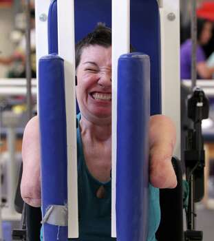 Katy Hayes pushes weight to strengthen her shoulders and chest during her physical therapy at The Institute for Rehabilitation and Research Memorial Hermann, in Houston, Texas, Thursday, September 16, 2010. After the birth of Katy Hayes daughter, Arielle, Katy began to experience a series of complications resulting from a Streptococcal A infection. As a result, Katy experienced multiple organ failure and the loss of her arms and legs. Hayes is currently in the first week of a two week intense physical therapy program. Hayes now in 24 hour care at TIRR Hermann Memorial is spending at least three hours a day on physical and occupational therapy. Photo: Billy Smith II, Houston Chronicle / Houston Chronicle