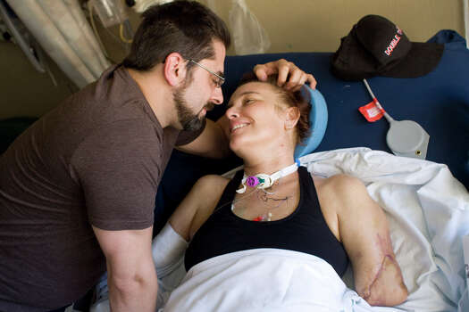 Al Hayes smiles as he moves in to kiss his wife Katy Hayes, Wednesday, May 5, 2010 . while in the in patient area of Parkland Hospital in Dallas, Texas. On February 10, 2010  Katy and Al Hayes had their third child, Arielle. but just days after the baby's birth, Katy experienced intense abdominal pain and was rushed to the hospital. There, the Hayes's discovered that Katy had been infected with Streptococcal, an infection that causes aggressive toxins to multiply and cause damage to tissues and organs.  To save her life, doctors performed a dozen surgeries, including amputating both arms and legs above the middle joints. Photo: Billy Smith II, Chronicle / DirectToArchive