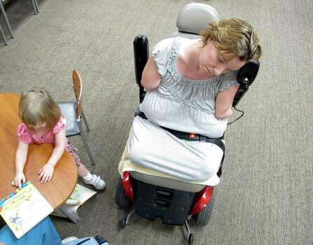 Two year-old daughter Arielle Hayes plays while her mother Katy Hayes stresses about and her radiology appointment  Tuesday 22, 2012 at Kingwood Medical Center in preparation for her arm transplants. Photo: Billy Smith II, Chronicle / © 2012 Houston Chronicle