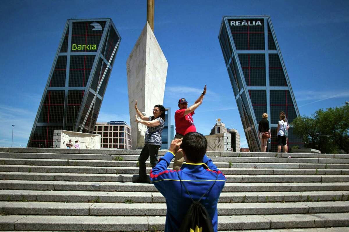 Visitors position themselves for photos of the Kio towers, the headquarters of troubled Bankia, in Madrid. Bankia is seeking a $23.9 billion bailout.