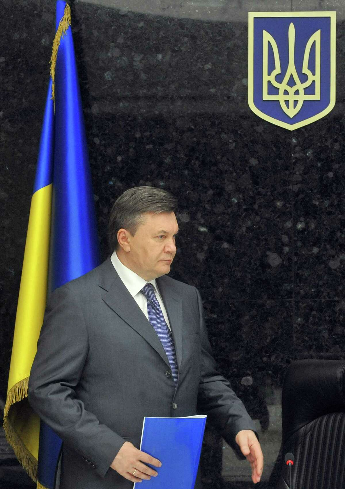 Ukrainian President Viktor Yanukovych arrives to a coordinating headquarter meeting in Dnipropetrovsk, eastern Ukraine, on April 28, 2012. Four explosions went off in a busy area of central Dnipropetrovsk on April 27, wounding 26, the emergency situations ministry said today. The authorities gave conflicting totals, however, with the health ministry saying 30 were wounded. The first bomb, hidden in a rubbish bin, exploded shortly before noon on April 27, followed by three more blasts over the next hour, all in the same busy part of the city on the Dniepr River. AFP PHOTO / STRINGERSTR/AFP/GettyImages
