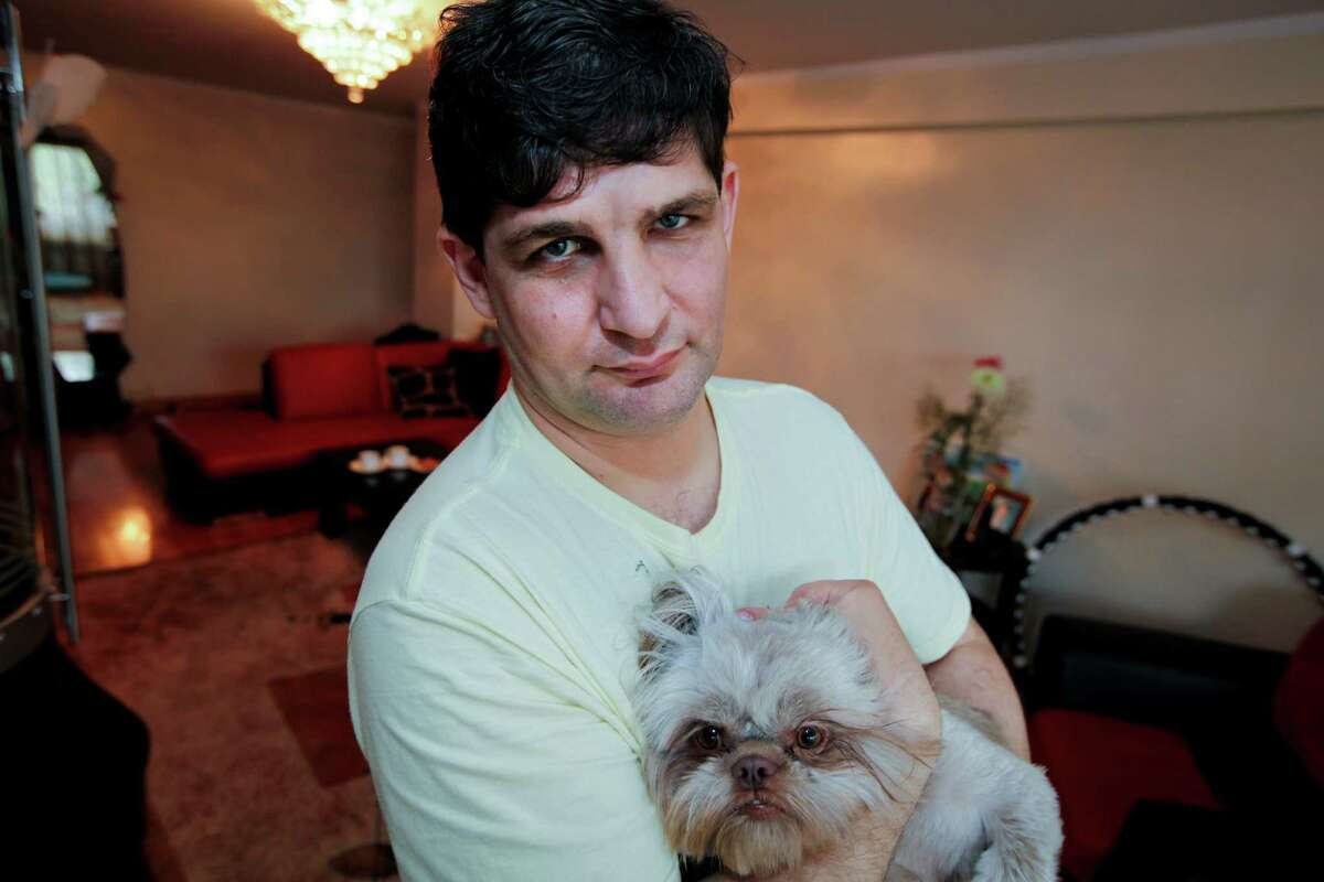 Eugene Ovsishcher, a U.S. Army veteran of Afghanistan, says his dog, Mickey, has helped him deal with symptoms of post-traumatic stress.