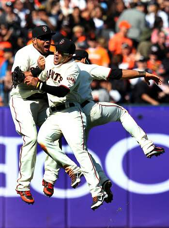 Melky Cabrera, Gregor Blanco and Angel Pagan get a jump on celebrating the Giants' 4-2 win. Photo: Lance Iversen, The Chronicle
