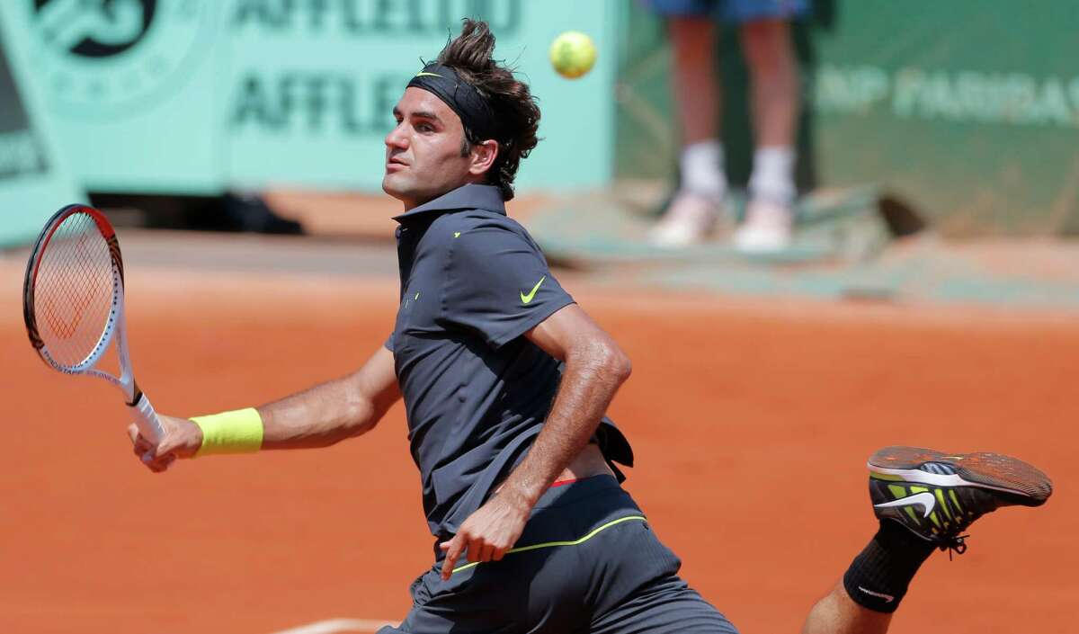 Switzerland's Roger Federer returns the ball to Germany's Tobias Kanke during their first round match in the French Open tennis tournament at the Roland Garros stadium in Paris, Monday, May, 28, 2012. (AP Photo/Bernat Armangue)