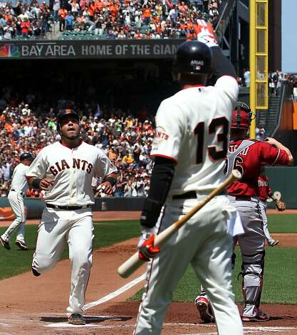 San Francisco Giants Hector Sanchez scores off Brandon Belt's first inning triple against the Arizona Diamondbacks Monday May 28, 2012 at AT&T Park in San Francisco California. Giants won 4-2. Photo: Lance Iversen, The Chronicle