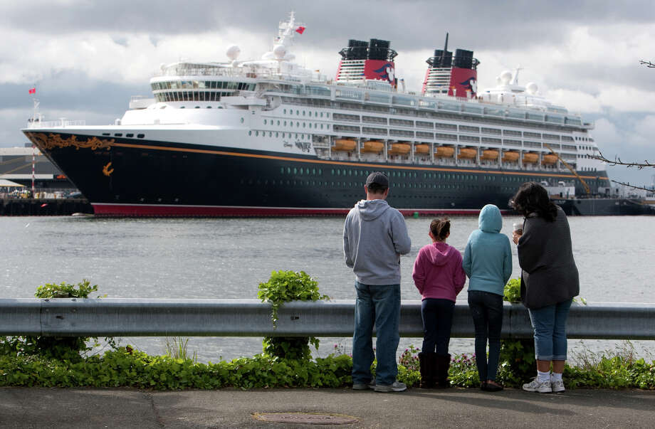 From left, Terry Aiello Lydia Aiello, 8, Abby Aiello, 11, and Regina Aiello look at the Disney Cruise ship Wonder on Monday, May 28, 2012 in Seattle. The family plans to take a future cruise on the ship . On Monday the ship made its first stop in Seattle. The cruise liner will be based out of Seattle for the next 14 weeks, sailing to Alaska and Victoria, B.C. The 2,700 passenger Disney Wonder will sail out of Seattle and in September will return to Los Angeles where it will sail to the Mexican Riviera. Photo: JOSHUA TRUJILLO / SEATTLEPI.COM