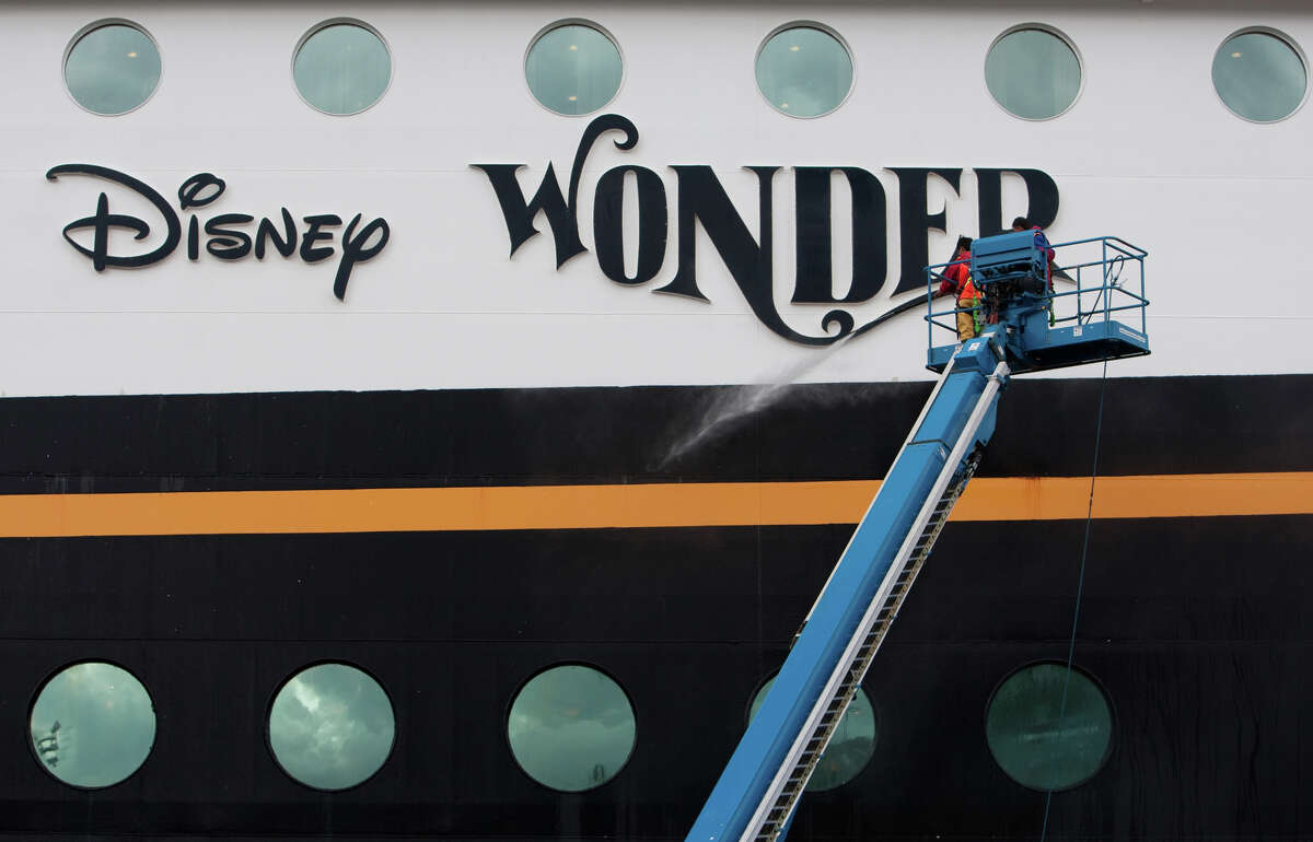 Crews pressure wash the Disney Wonder. On Monday the Disney Cruise liner made its first stop in Seattle. The ship will be based out of Seattle for the next 14 weeks.