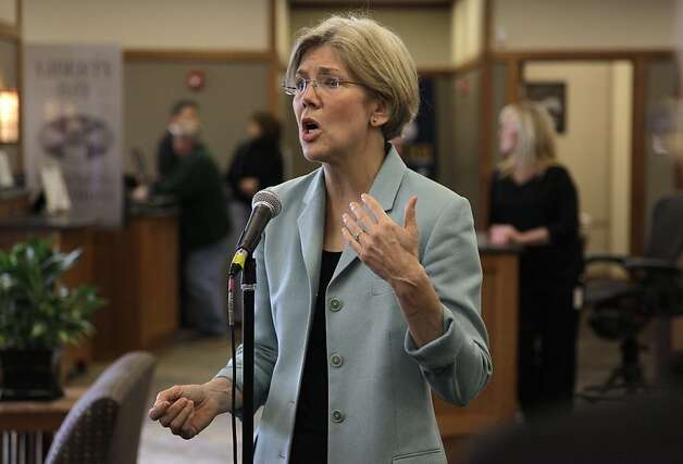 In this May 2, 2012 photo, Democratic candidate for the U.S. Senate Elizabeth Warren faces reporters during a news conference at Liberty Bay Credit Union headquarters, in Braintree, Mass.  Warren addressed questions on her claim of Native American heritage. (AP Photo/Steven Senne) Photo: Steven Senne, Associated Press
