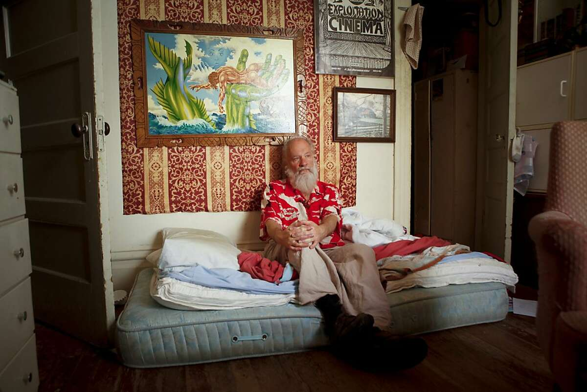 """Mike Kuchar, seen in his San Francisco, Calif., Mission district bedroom on Thursday, May 17, 2012, along with his late twin brother, George, was a star of the """"underground"""" film scene of the 1960s and '70s."""