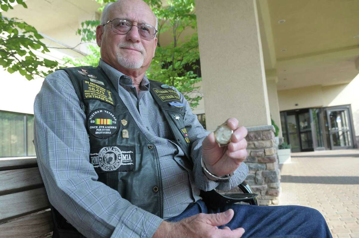 Vietnam veteran Jim Schweickert holds a gold watch, given to him for safe keeping in August of 1967, by another soldier he did not know well who was heading out on a mission in Vietnam. The soldier, Frank Cook, did not come back and then Schweickert was called out on a mission and then finished his tour and was shipped home. For the longest time Schweickert thought the soldier had been killed but just recently he found out that Frank Cook was still alive and Schweickert, who lives in California came to Albany to return the watch.