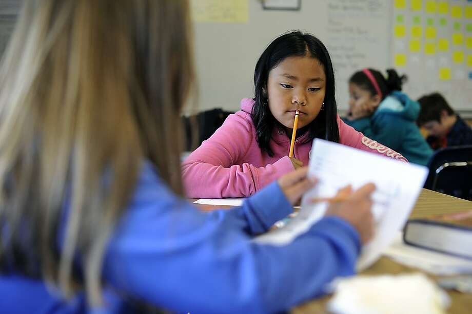 Jaslynn Tran pauses to think as she works out an equation during a math quiz in Anna Speiglman's 4th grade class at Malcom X Elementary School in Berkeley, CA Friday May 25th, 2012 Photo: Michael Short