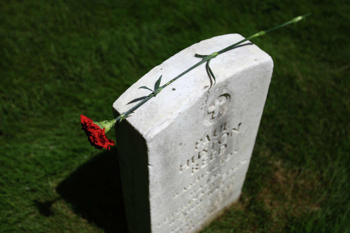 A flower is shown on a headstone at Fort Lawton Military Cemetery on Memorial Day, Monday, May 28, 2012.