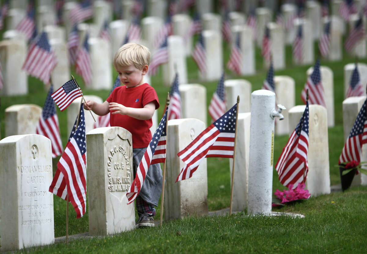 Seth Langford, 3, walks among the headstones during the annual Memorial Day celebration at the Evergreen-Washelli Seattle Veterans' Memorial Cemetery.