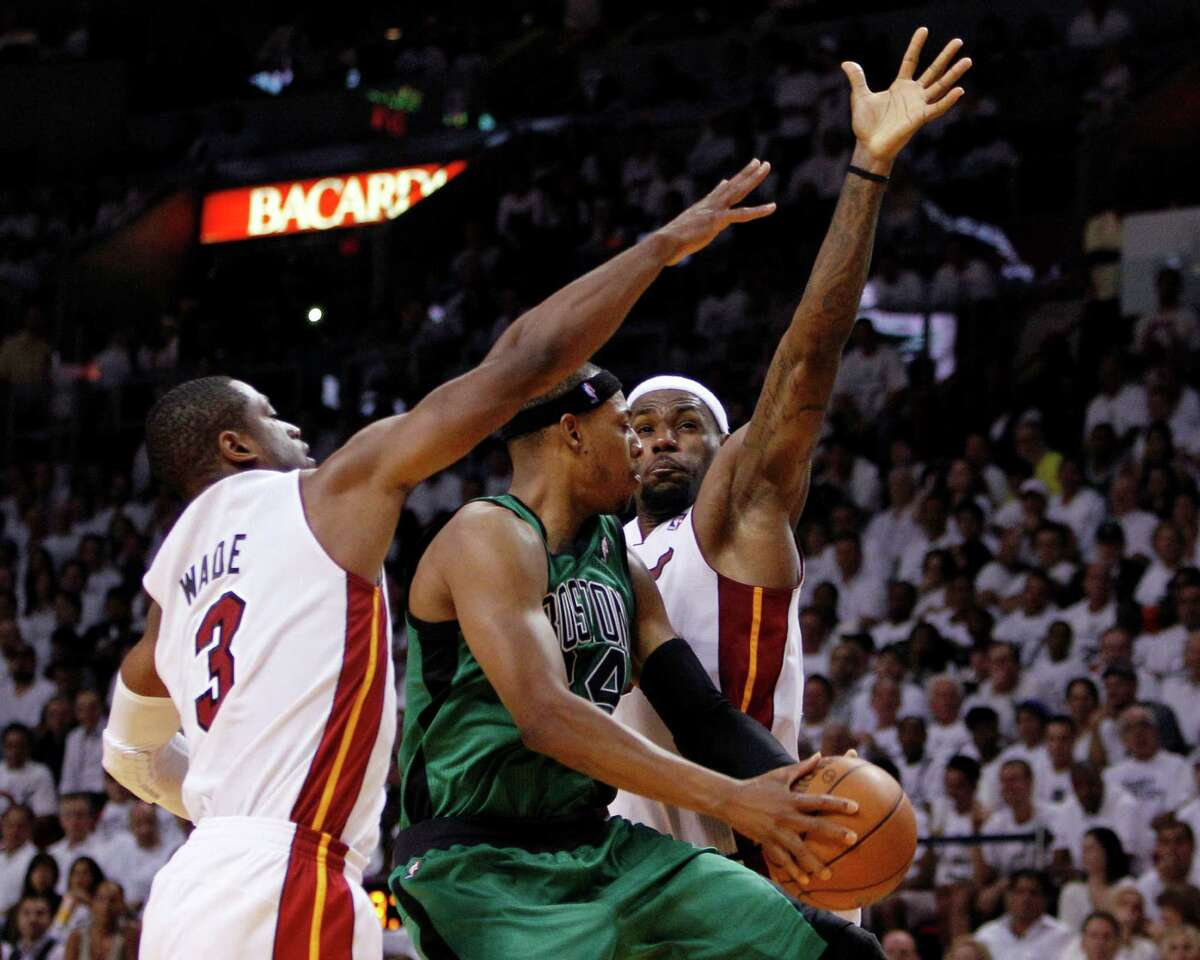 Miami's Dwyane Wade, left, and LeBron James make life difficult for Boston's Paul Pierce during the second half of the Heat's Game 1 win Monday night in Miami. Pierce was held to 12 points and two rebounds in the Celtics' 93-79 loss.