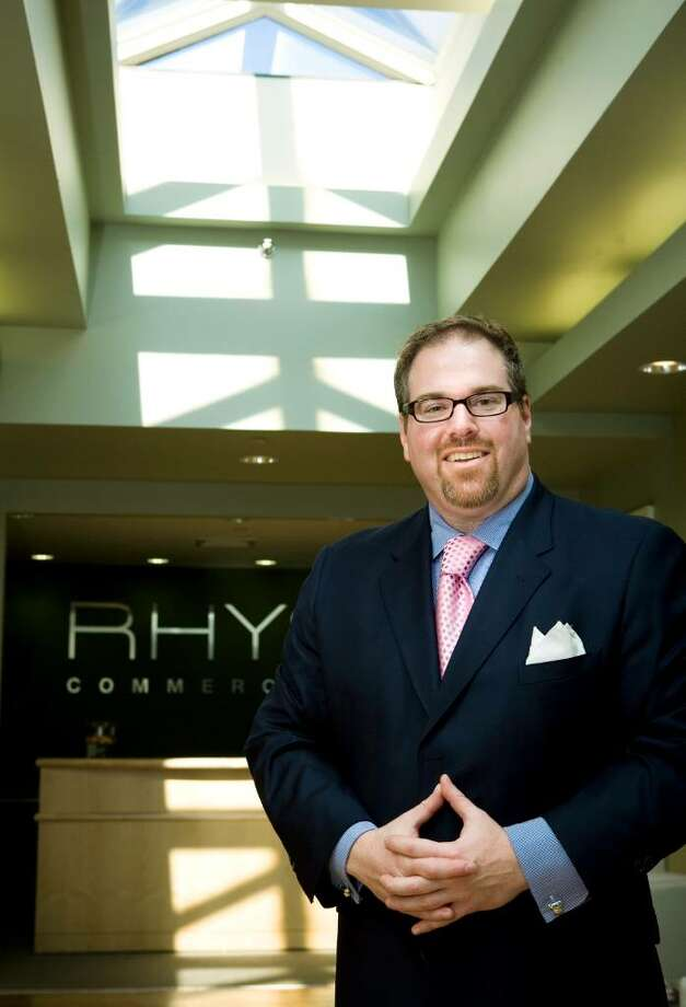Cory Gubner recently started RHYS, his own commercial real estate firm. He is photographed at their office on West Park Place in Stamford. Photo: Kerry Sherck / Stamford Advocate Freelance