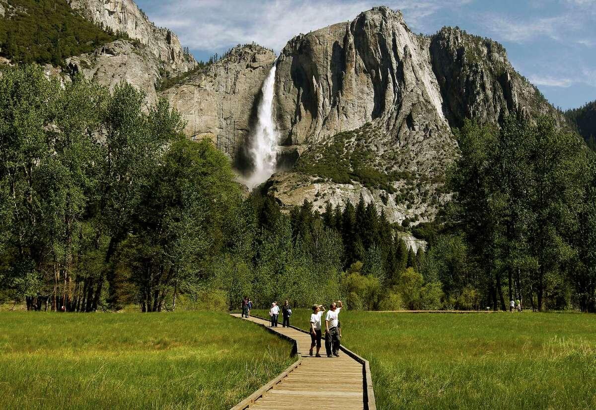 Visitors enjoy the views against the backdrop of Yosemite Falls, at Yosemite National Park, on Saturday May 12, 2012
