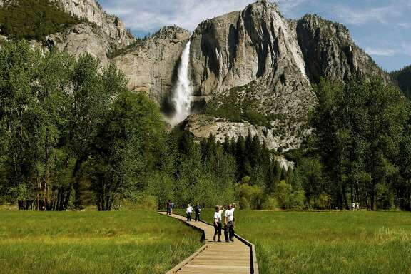 Visitors to Yosemite National Park savor the views beneath Yosemite Falls. Park officials said fee increases announced last week would generate the revenue needed for vital maintenance work and restoration projects while addressing public concerns, raised via e-mail and Facebook, about the additional cost.