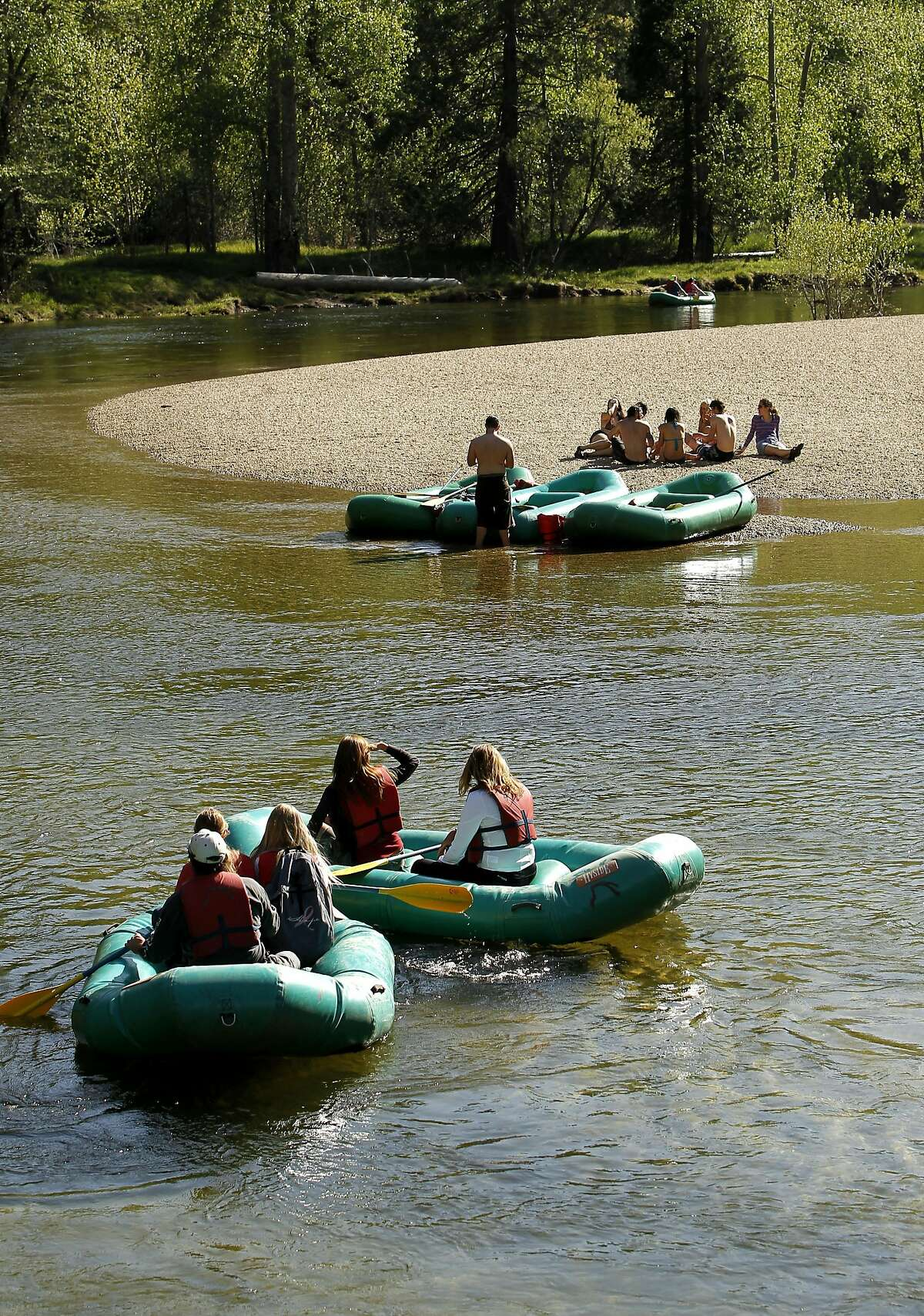 Rafters drift along the Merced River in Yosemite National Park, on Friday May 11, 2012.