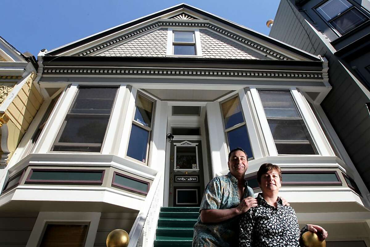 Nick and Mary Anne Tortorelli stand on their front steps of their Noe Valley Queen Anne home that they hope to rent out to Americas Cup visitors to San Francisco for $30,000 a month. Friday, May 11, 2012 in San Francisco California.