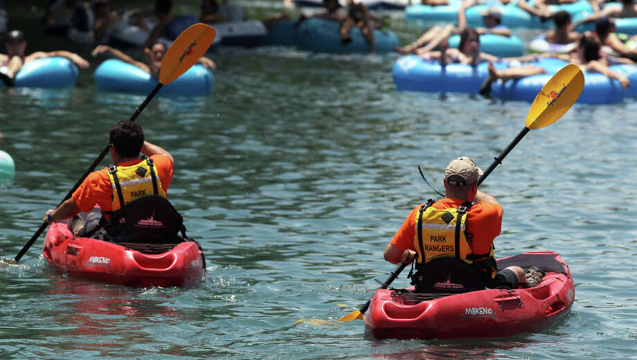 Park Rangers patrol the Comal river in New Braunfels Memorial Day during the can ban. Photo: San Antonio Express-News