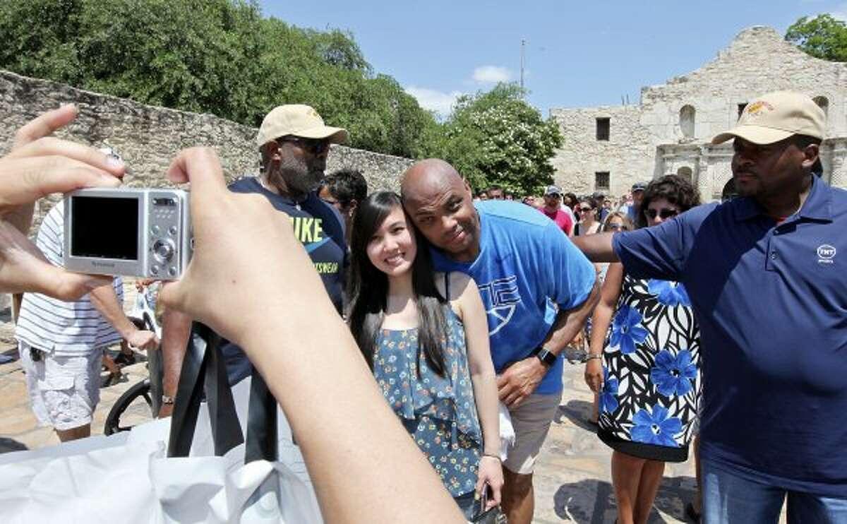 Basketball legend and TNT studio host Charles Barkley photo-bombs Joann Nguyen at the Alamo while visiting San Antonio on Monday, May 28, 2012.