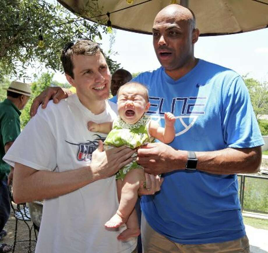 Basketball legend and TNT studio host Charles Barkley poses for a picture with Doug Hilbert and 6-month-old daughter Leila Mei Hilbert at La Gloria Ice House while visiting San Antonio on Monday, May 28, 2012.