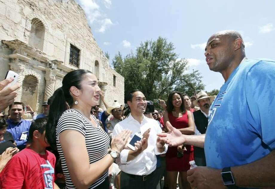 Basketball legend and TNT studio host Charles Barkley jokes with Mayor Julián Castro and his wife, Erica Lira Castro, at the Alamo while visiting San Antonio on Monday, May 28, 2012.