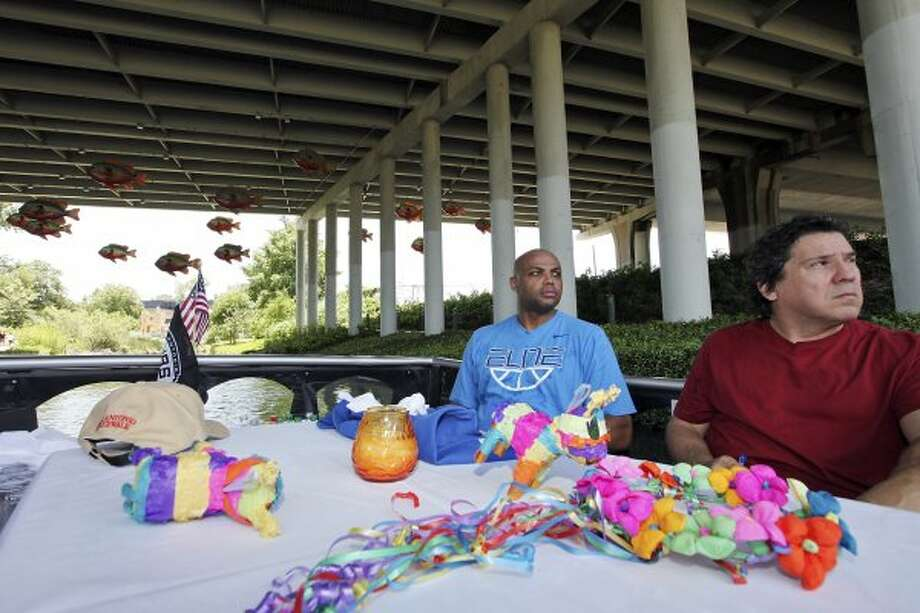 Basketball legend and TNT studio host Charles Barkley (left) and San Antonio Express-News columnist Roy Bragg take in the sights on the Museum Reach section of the San Antonio River on Monday, May 28, 2012.