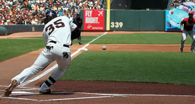 San Francisco Giants Brandon Crawford sacrifice bunt advanced Gregor Blanco to second base during their MLB baseball game against the Arizona Diamondbacks Monday May 28, 2012 at AT&T Park in San Francisco California. Giants won 4-2. Photo: Lance Iversen, The Chronicle