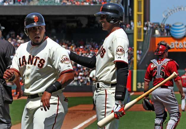 San Francisco Giants catcher Hector Sanchez left is greeted at home plate by Joaquin Arias after scoring in the first inning of their MLB baseball game against the Arizona Diamondbacks Monday May 28, 2012 at AT&T Park in San Francisco California. Giants won 4-2. Photo: Lance Iversen, The Chronicle