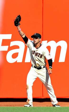 San Francisco Giants right fielder Gregor Blanco catches Arizona Diamondbacks, Ryan Roberts deep fly ball for the final out in the ninth inning of their MLB baseball game Monday May 28, 2012 at AT&T Park in San Francisco California. Giants won 4-2. Photo: Lance Iversen, The Chronicle